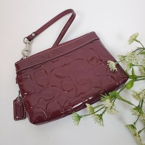 COACH Patent Leather Signature Embossed Wristlet…